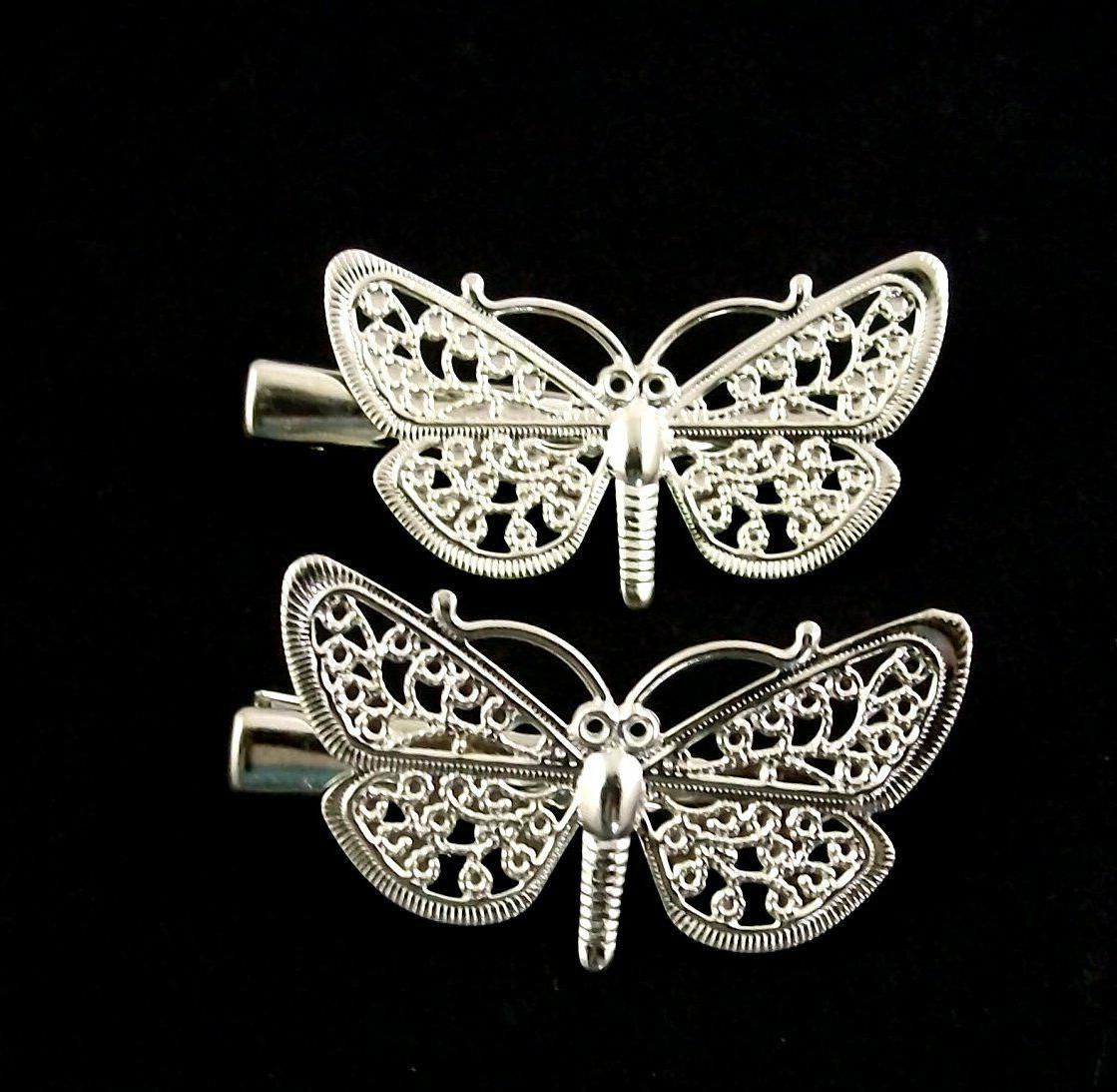 2 x silver filagree type hair clips